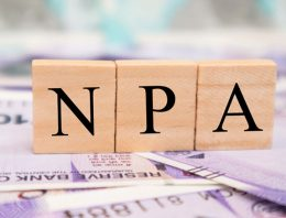 What is a non-performing asset (NPA) in real estate?